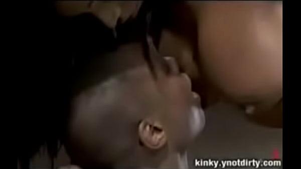 Ebony Tranny fucks a guy bound in metal restraints