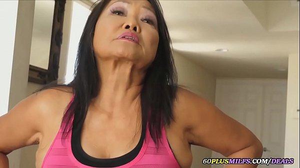 thai grandma plays with a sex machine Thumb