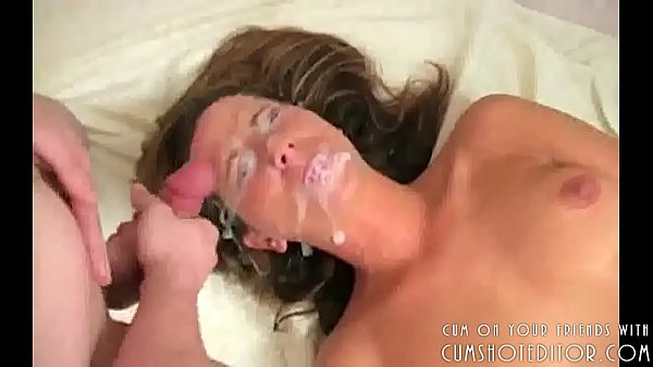 Covering Her Pretty Young Face With Cum