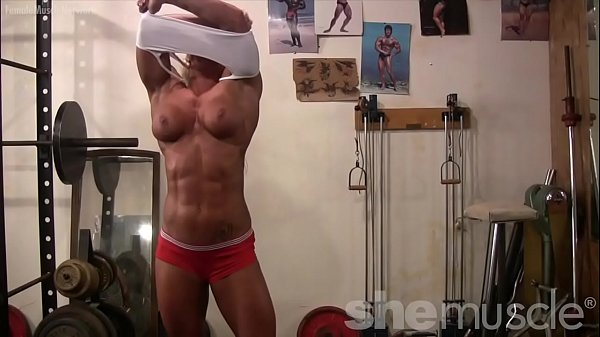 Topless Female Bodybuilder With Amazing Physique in the Gym