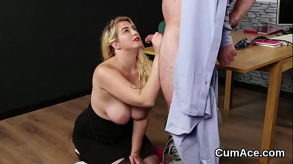 Spicy babe gets cum shot on her face eating all...