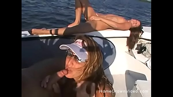 Horny blonde fucks her husband and girlfriend on a boat