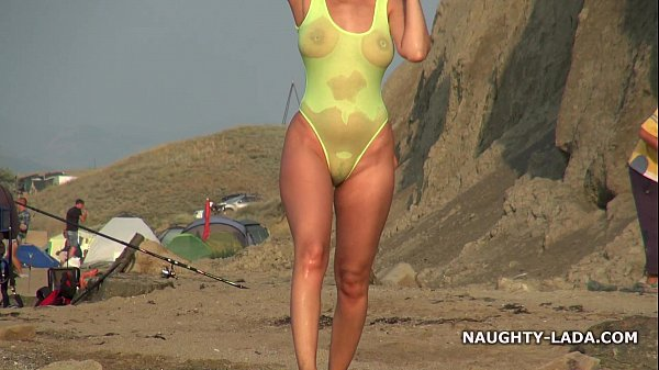 Transparent swimsuit and nude on the beach