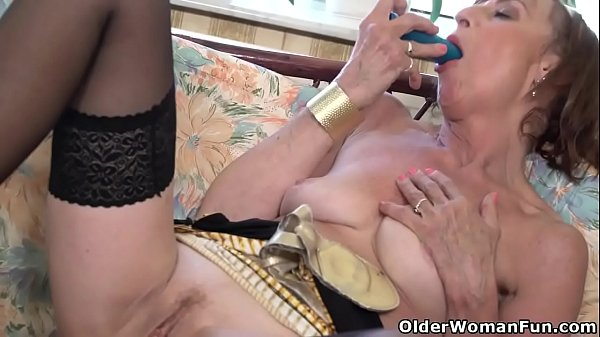Sexy granny Danina pleases her pussy in front of window Thumb