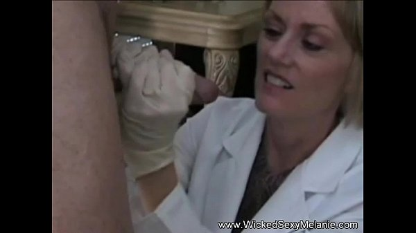 Mature Doctor Oral Examination