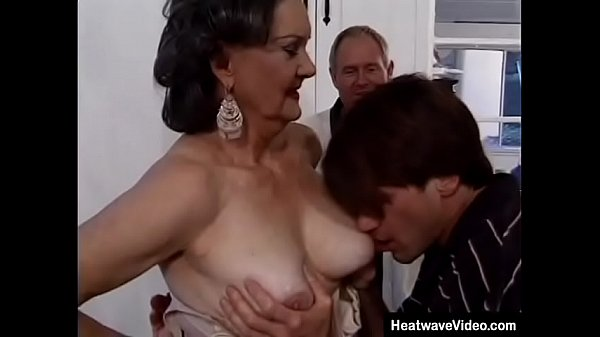 Old husband offers his mature wife to a young s...