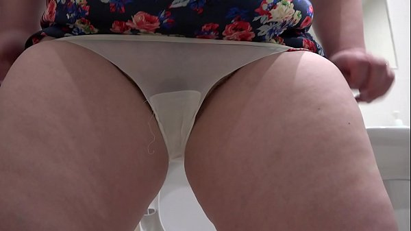 Pissing in white panties, the milf shows natura...
