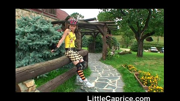 Little Caprice learns roller skating naked outd...