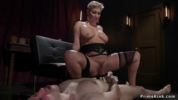 Busty MILF femdom pisses man slave