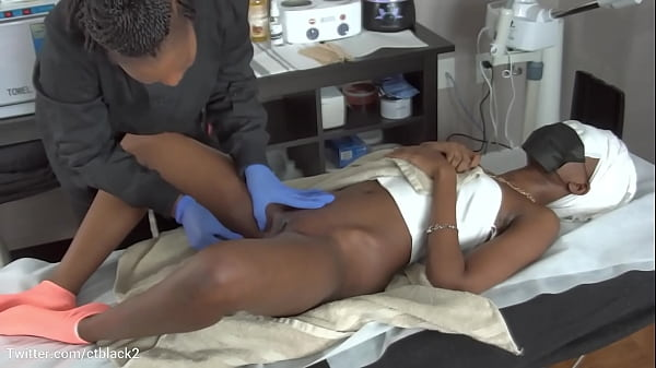 Black chick getting waxed