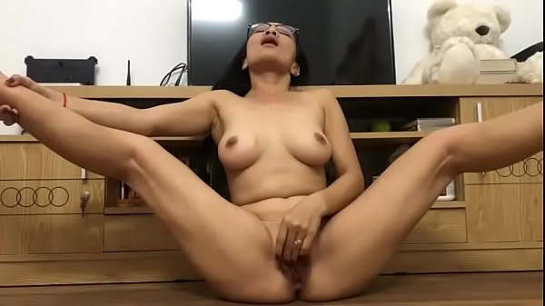 Horny Asian Mature Plays With Her Pussy