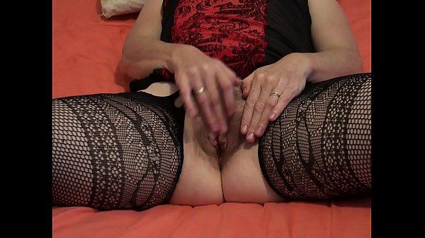 Keeps her legs wide apart masturbating her hairy beaver to orgasm