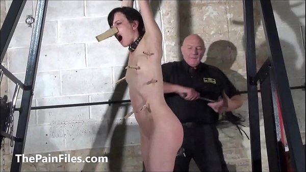 Cruel whipping of slave Elise Graves in dungeon bondage and merciless bdsm