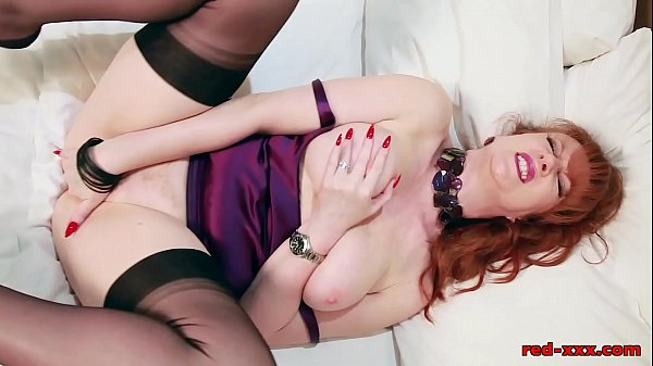 Redhead In Lingerie Masturbating And Vibrates Her Pussy On The Bed Thumb