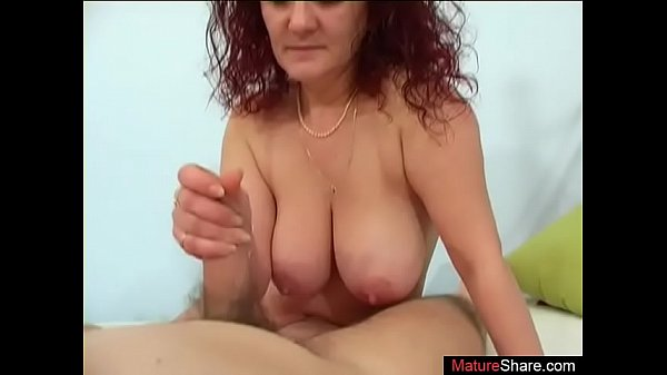 Curly haired mature shakes tits when sucking co...