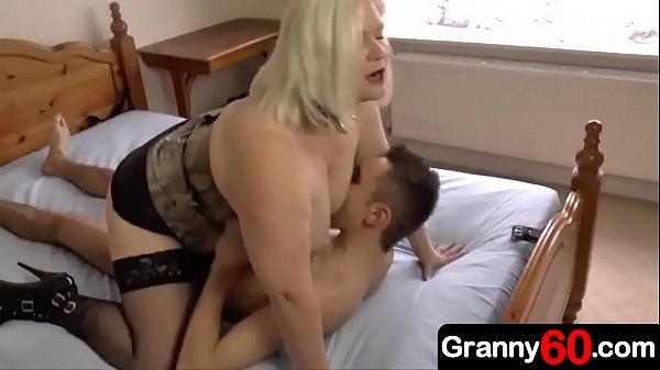 Horny busty grandma dominates her grandson and fucks him hard