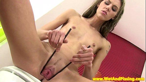 Urine fetish brunette toying both holes