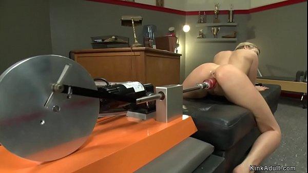Blonde athlete squirts on machine