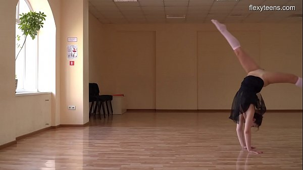 Super flexible Tonya making gymnasts positions before the camera. Thumb