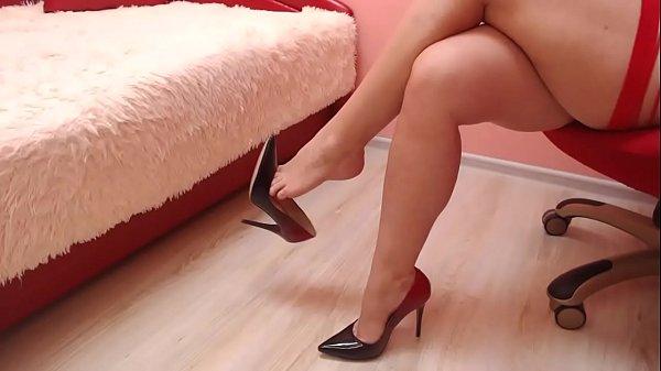 Dangling with beautiful high heel shoes. Thumb
