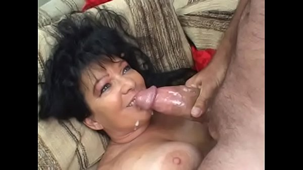 Darkhaired cougar with big boobs in red transparent outfit Ginni Lewis is ready to pay private investigator looser his hourly wages if he agrees to do her bidding Thumb