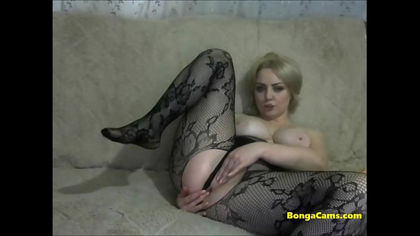 Gorgeous blonde MILF in black tights uses a big...