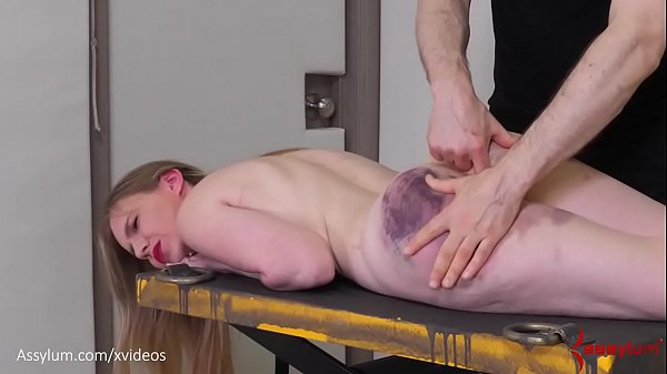 Bruised blond gets fed piss, then hung from her...