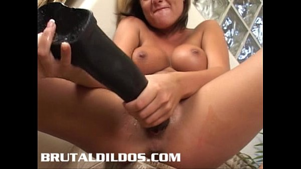 Sophia taking a big long black b. dildo in her mouth and pussy