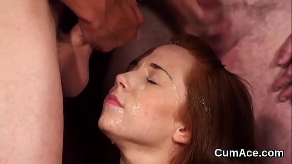 Flirty honey gets cum shot on her face sucking all the jism