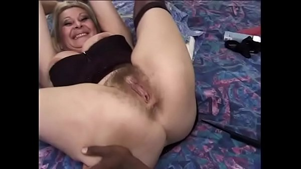 Mature blonde lady Anastasia Sands warms up her her bushy twat waiting for big black dong of her y. lover