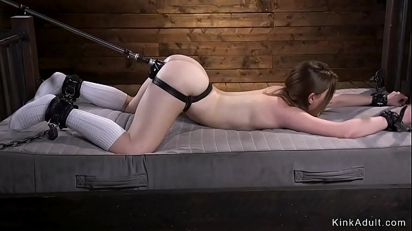 Babe tied up to bed frame fucks machine
