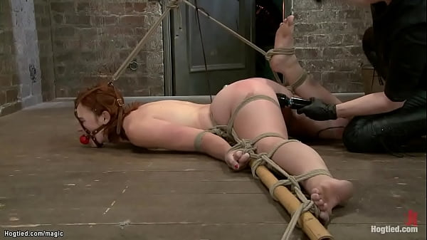 Tied redhead on the floor ass hooked