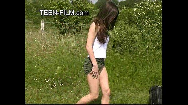 brunette teen pissing in forest