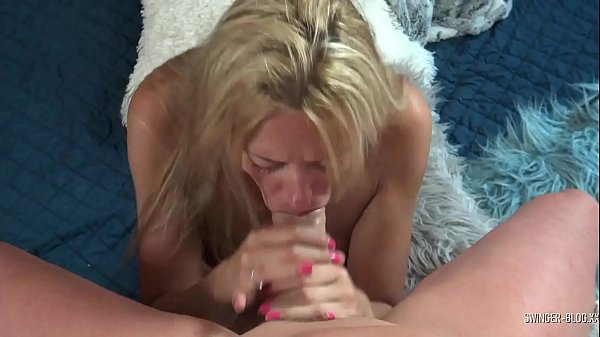 Blonde amateur swinger MILF giving a sloppy blowjob