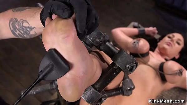 Huge tits slave locked in metal device
