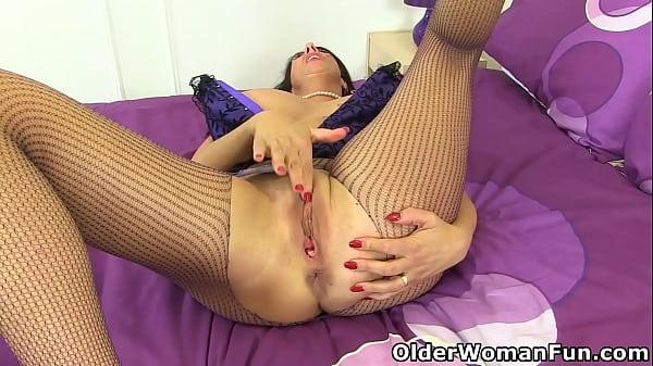 English milf Lulu wears fishnet tights and fucks a dildo Thumb