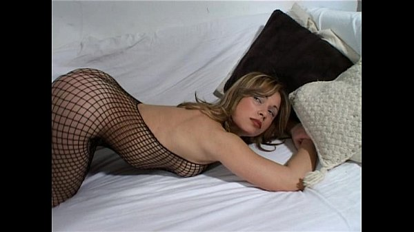 Pretty blonde Sara May doing a strip on the sofa