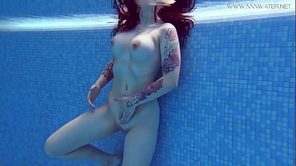 Sheril Blossom gets horny and naked in the pool