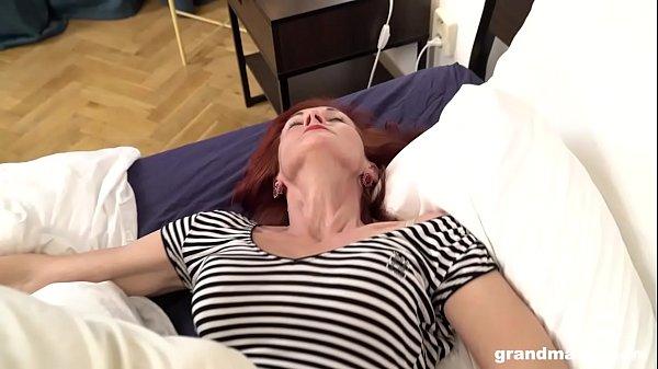 Skinny redhead grandma picks up boy and licks h...