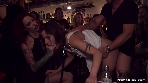Naked cutie gangbanged in public bar