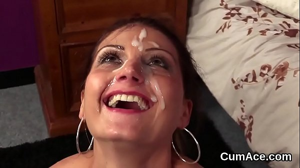 Flirty honey gets jizz load on her face eating all the cum