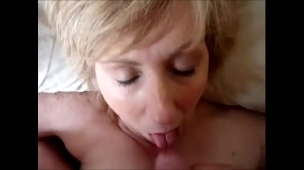 Mature wife blowing cock