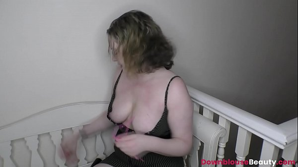 Busty Amber West showing off her downblouse