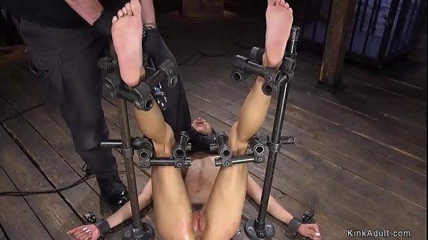 Ebony gets feet caned on device bondage
