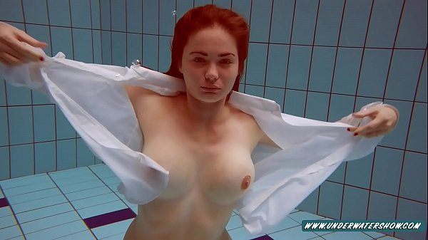 Lola enjoys showing her sexy boobs