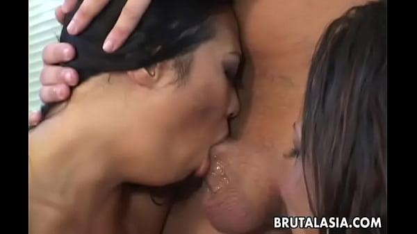 Ebony babe and an Asian slut fuck in a threesome