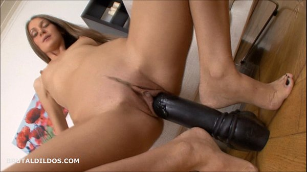 Thin brunette stretching her pussy with thick dildos Thumb