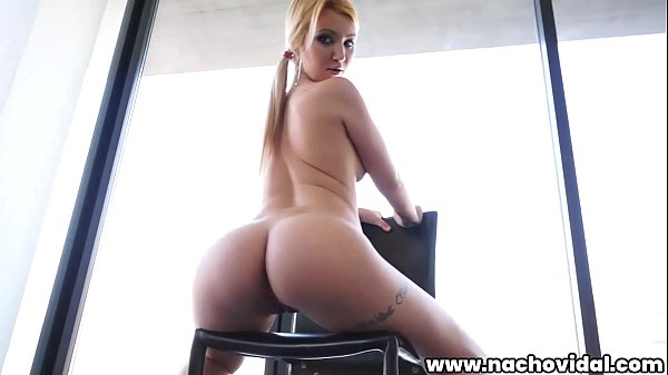 The pretty blonde is a model that Nacho Vidal was photographing her natural tits and curvy ass. He takes her thong off and she sucks Nacho's giant cock and then fucks her sitting on a chair