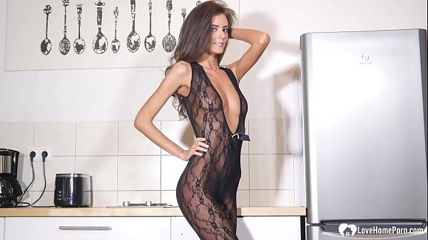 Desirable brunette wears a black seethrough bodysuit