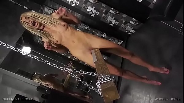 BDSM games of a yelling skinny blondie . Wooden horse .